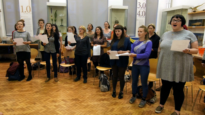 image of the choir rehearsing at Manchester Museum's Wonderstruck event