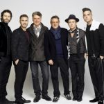 image of Howard Donald, Gary Barlow, Dafydd Rogers, David Pugh, Mark Owen and Robbie Williams. image credit Jay Brooks