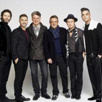 image of Howard Donald, Gary Barlow, Dafydd Rogers, David Pugh, Mark Owen and Robbie Williams. image credit Jay Brooks