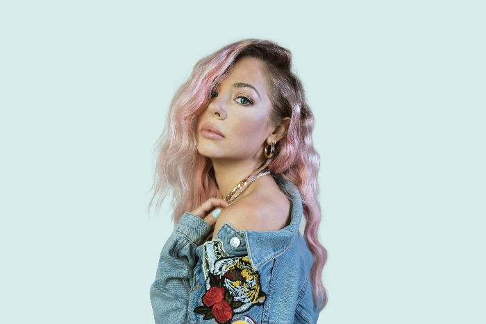 MacKenzie Porter releases new single and new collection Drinkin' Songs